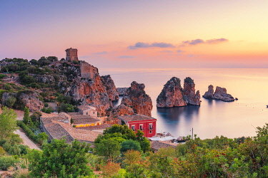 ITA15971AW Scopello, Sicily. Elevated view of the tonnara and the sea stacks at dawn