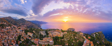 ITA16018AW Taormina, Sicily. Aerial view of the Greek theater with the sun rising on the sea in the background
