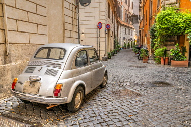 ITA16131AW Old classic Fiat 500 car parked in a cobbled street of Rome, Lazio, Italy