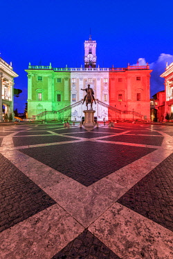 ITA16187AW Piazza del Campidoglio with Palazzo Senatorio illuminated with the colors of the Italian flag, Rome, Lazio, Italy