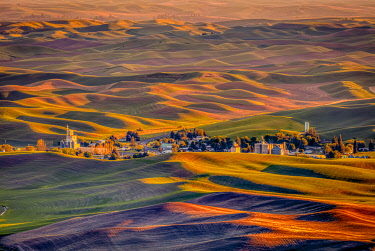 US48BJY1430 USA, Washington State, Palouse. Steptoe Village and farmland at sunset
