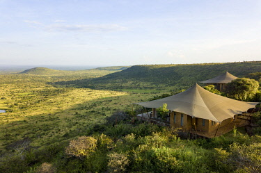 KEN11649 Elewana Loisaba Lodo Springs, Kenya, aerial image of the guest accommodation in the stunning landscape.