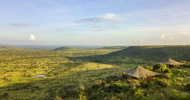 KEN11650 Elewana Loisaba Lodo Springs, Kenya, aerial image of the guest accommodation in the stunning landscape.