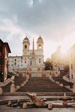 ITA16325AWRF The Spanish Steps (Italian: Scalinata di Trinità dei Monti)  in Rome, Italy, climbing between the Piazza di Spagna at the base and Piazza Trinità dei Monti, with church at the top. Sunrise, no peopl...