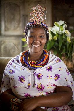 KEN11729 Campi ya Kanzi, Chyulu Hills, Kenya, portrait of a Maasai woman in the mess area.