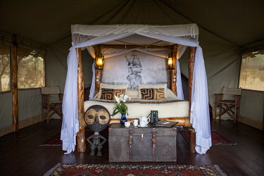 KEN11764 Campi ya Kanzi, Chyulu Hills, Kenya, a luxurious four poster bed in a guest tent.