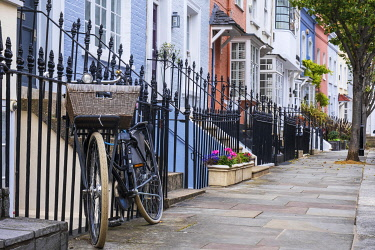 ENG18146AW UK, England, London, Kensington and Chelsea, street of colourful houses, luxury residential real estate, domestic vernacular architecture
