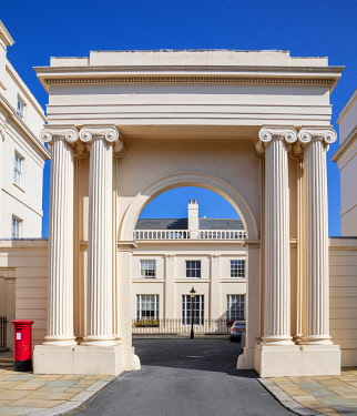 ENG18160AW Europe, UK, England, London, Camden, Regent's Park, neo-classical Regency style architecture, architect John Nash, early 19th Century, residential buildings, view of mews house through an arch, no peo...