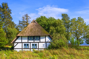 GER12498AW Thatched roof house at Freesenort, Rugen, Germany
