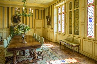 FRA12064 France, Dordogne, Marqueyssac, an elegant dining room.