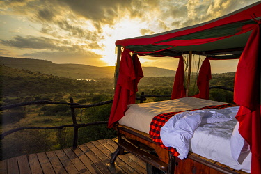 Elewana Loisaba Star Beds, Loisaba Conservancy, Kenya, star bed at sunrise.