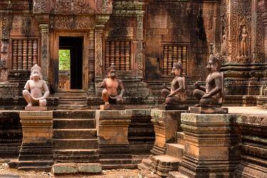 IBLSBE04137099 Yaksha Guardian, ape-like guardian figures in front of the Mandapa, Khmer Hindu temple Banteay Srei, Angkor region, Siem Reap Province, Cambodia, Asia