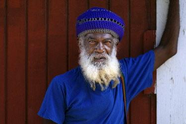 ANB0032AW Caribbean, Antigua, portrait of man outside his home, St John's