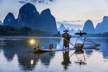 CH12543AW Cormorant fisherman throwing net on Li River at dawn, Xingping, Yangshuo, Guangxi, China
