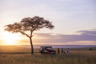 Rekero, Masai Mara, Kenya, guide and guests taking in the sunset