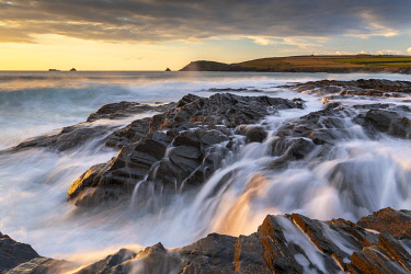 Crashing waves over the rocky shores of Boobys Bay at sunset on the North Cornwall Coast, England. Autumn (October) 2020.