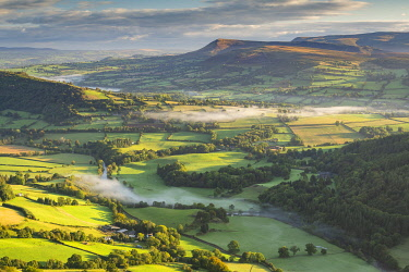 WAL7844AW Wisps of mist float over the Usk Valley on an autumnal morning, Brecon Beacons, Powys, Wales, UK. Autumn (October) 2019.