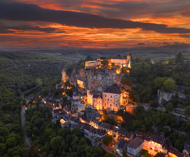 FRA12133AW France, Occitanie, Lot, Rocamadour illuminated at sunset