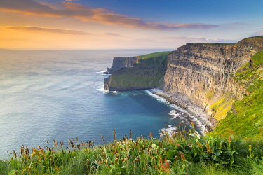 CLKMC133088 View of a sunset at the Cliffs of Moher. County Clare, Munster province, Ireland.