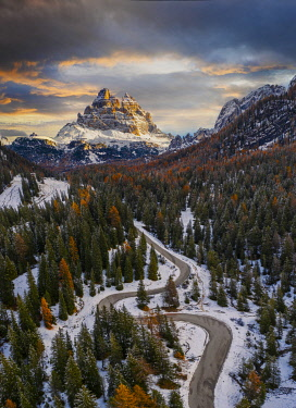 CLKMB139783 Aerial view of road to Tre Cime di Lavaredo at sunrise, Misurina, Belluno, Auronzo di Cadore, Veneto, Italy