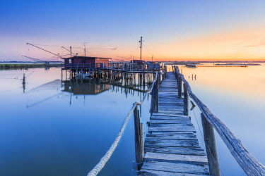 Fishing hut on stilts in the Comacchio lagoon at dawn, Ferrara, Emilia Romagna, Italy