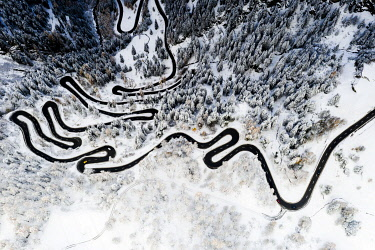 CLKRM133888 Serpentine road crossing the snowy woods, aerial view, Maloja Pass, Bregaglia Valley, Graubunden, Engadine, Switzerland