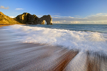ENG18525AW Durdle Door with surf on beach, Jurassic Coast, Dorset, England