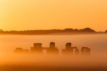 ENG18605AW Stonehenge at sunrise in midsummer, Salisbury Plain, Wiltshire, England