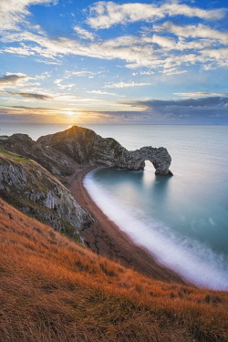 ENG18700AW Durdle Door at sunrise, Jurassic Coast, Dorset, England