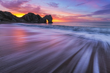 ENG18702AW Durdle Door at sunrise, Jurassic Coast, Dorset, England