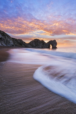 ENG18704AW Durdle Door at sunrise, Jurassic Coast, Dorset, England
