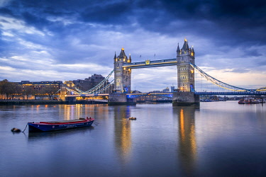 ENG18809AW UK, England, London, City of London / Southwark, Tower Bridge reflected in the River Thames at dusk