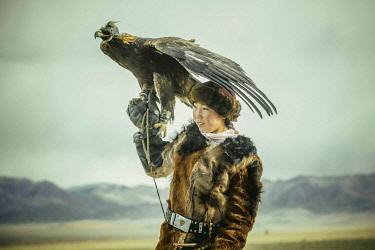 IBLFBA05905350 Portrait of a young eagle hunter, Festival of eagle hunters in the province of Olgii, about 20 km from the provincial capital, Olgii, Mongolia, Asia