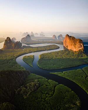 IBXLRE06004778 Aerial view, mangrove forest with meandering river and high karst rocks during sunrise, Ao Phang-Nga National Park, Phang-Nga Province, Thailand, Asia
