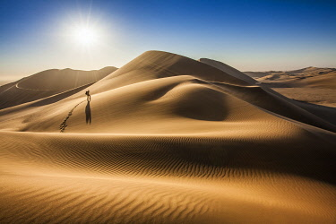 Single person walking over sand dunes near Swakopmund, Namibia