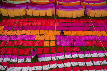 Drying multicolor cloth under sunlight, Narayanganj, Bangladesh.