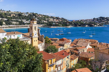 France, Alpes-Maritimes, Villefranche-sur-Mer, the Rade de Villefranche, the old town, the Saint-Michel church and the Cap Ferrat peninsula in the background