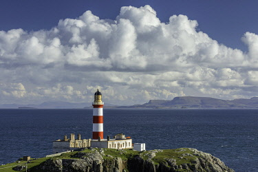 Eilean Glas Lighthouse looking over the Little Minch towards the Isle of Skye, Isle of Scalpay, Outer Hebrides, Scotland, UK