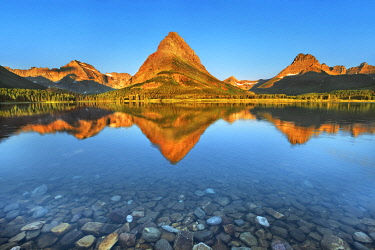 Swiftcurrent Lake with reflection of Mount Grinnell - USA, Montana, Glacier National Park, Many Glacier, Swiftcurrent Lake - Rocky Mountains