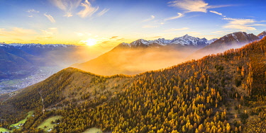 Aerial view of foggy sunset. Valtellina, Lombardy, Italy, Europe