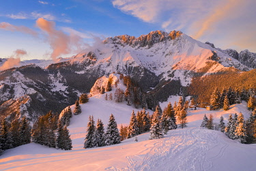 Aerial view of the Presolana covered in snow at sunset from Mount Scanapa. Castione della Presolana, Val Seriana, Bergamo district, Lombardy, Italy.