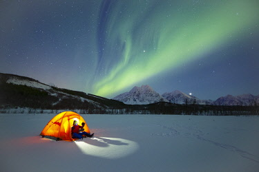 Europe, Norway, Troms: winter camping under the northern lights in the Lyngen Alps