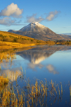 Ireland, Co.Donegal, Snow capped Errigal mountain reflected in Clady river