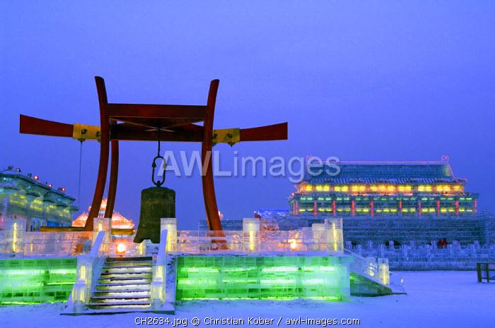 China, Northeast China, Heilongjiang Province, Harbin City. Ice Lantern Festival. A big bell - colourful ice sculptures illuminated at night.