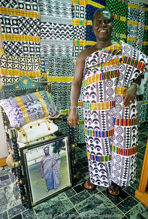 Ghana, Ashanti region, Timebabe. A Tribal Chief shows his collection of adinkra cloth.