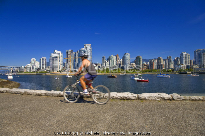 People cycling in Charleson Park along False Creek, Vancouver, British Columbia, Canada