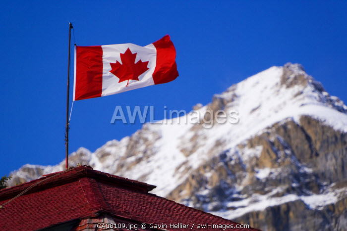 Canadian flag flying on rooftop next to Bow lake,  Banff-Jasper National Parks, Alberta, Canada