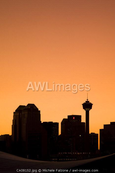 Skyline of downtown Calgary and Saddledome at dusk, Calgary, Alberta, Canada