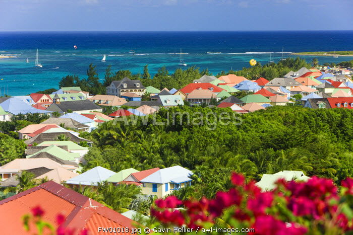 Caribbean, French West Indies, Saint Martin, colourful buildings at Orient Beach