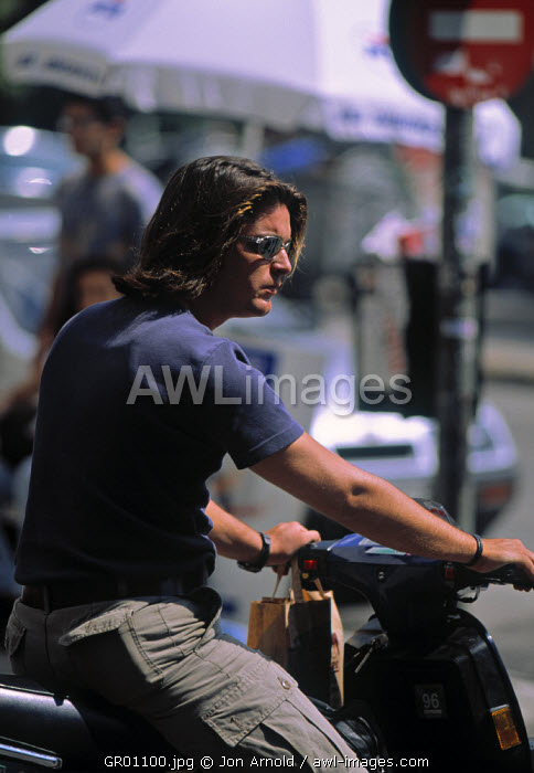 Man on scooter, Athens, Greece